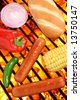 Hot dogs, bun, peppers, onion and corn on a hot barbecue grill - stock photo