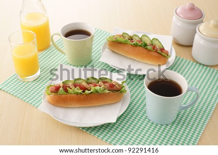 hot dogs, hot coffee and orange juice - stock photo