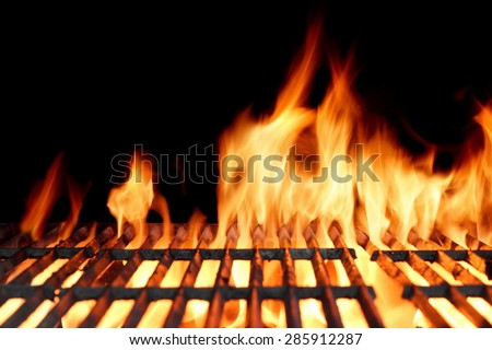 Hot Empty Clean Charcoal BBQ Grill With Vibrant Flames On The Black Background. Cookout Concept. - stock photo