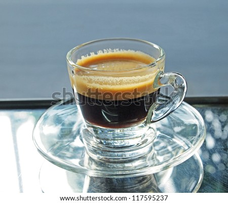 hot espresso coffee on a glass - stock photo