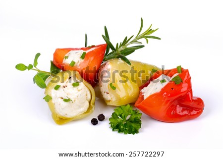 Hot green and red peppers stuffed with feta and cream cheese - stock photo