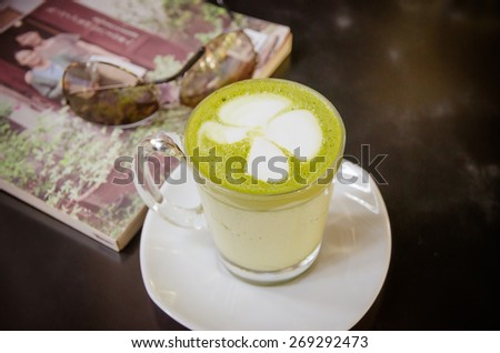 hot green Tea Latte on table on relax time - stock photo