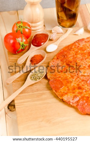 Hot Homemade Pepperoni Pizza Ready to Eat. - stock photo