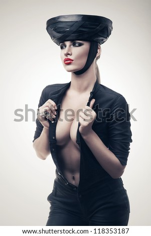 hot imperious woman in black - stock photo