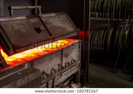 hot iron in furnace - stock photo