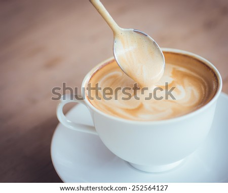 Hot latte in white cup  - stock photo
