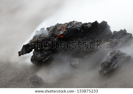 Hot lava steaming - stock photo