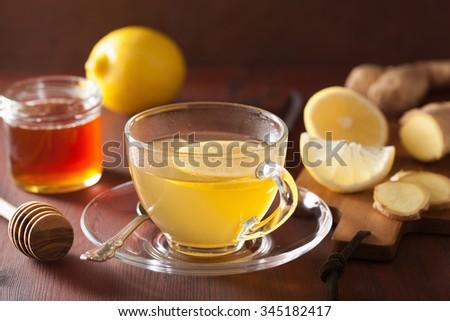hot lemon ginger tea in glass cup - stock photo