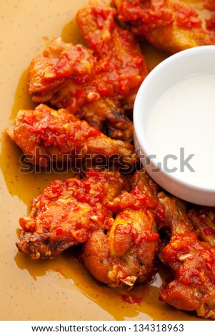 Hot Meat Dishes - Fried Chicken Wings with White Sauce - stock photo