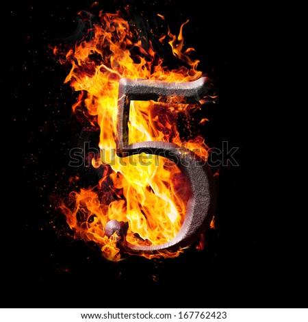 Hot metal burning numbers on black background - number five - stock photo