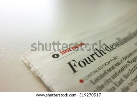 Hot news article paper print - stock photo