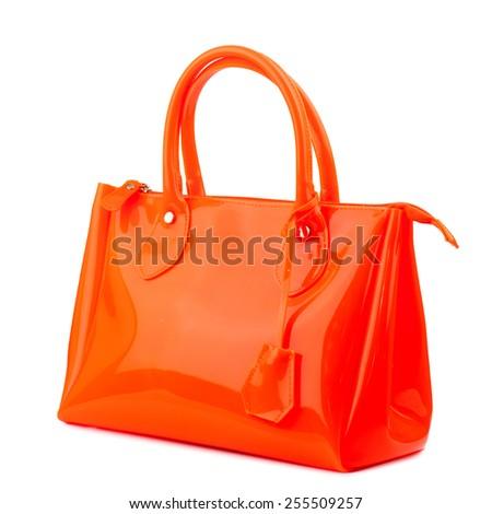 Hot orange glossy handbag isolated on white background. - stock photo