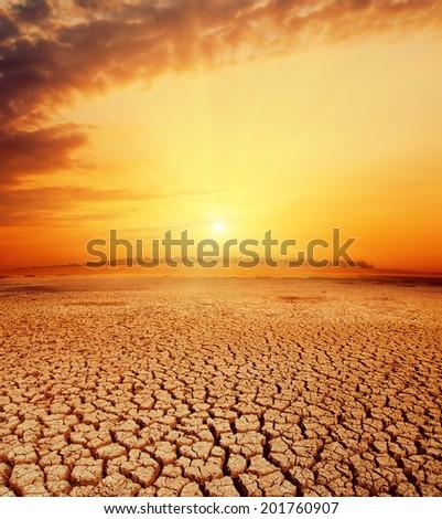 hot orange sunset over desert - stock photo
