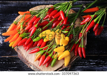 hot pepper on a dark wooden background old colorful vintage retro bitterly spice style - stock photo