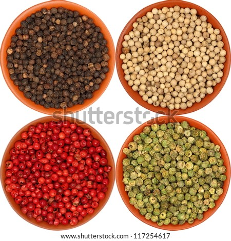 hot pepper, red pepper, black pepper, white pepper, green pepper, in a clay bowl, isolated, white background, texture - stock photo