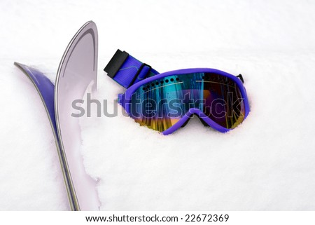 Hot Pink Ski Goggles and Skis in Snow - stock photo