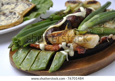 Hot plate of delicious Mexican food in studio - stock photo