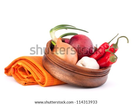 Hot red chili or chilli pepper in wooden bowl isolated on white background cutout - stock photo