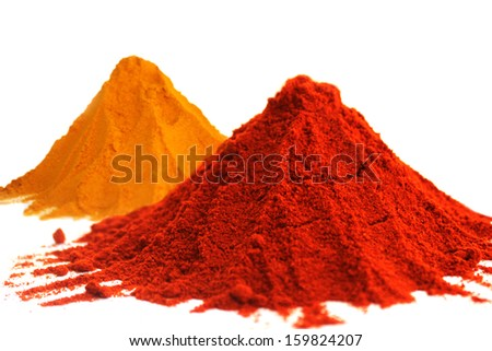Hot red chili powder and turmeric powder on white background - stock photo