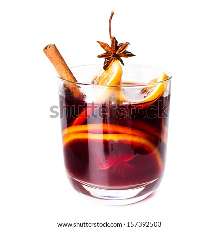 Hot red mulled wine for winter and Christmas with orange slice, anise and cinnamon sticks isolated on white background, closeup. - stock photo