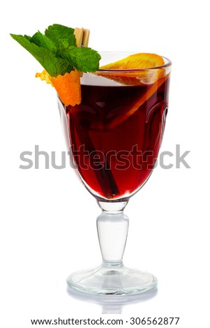 Hot red mulled wine isolated on white background with orange slice, mint and cinnamon sticks. - stock photo