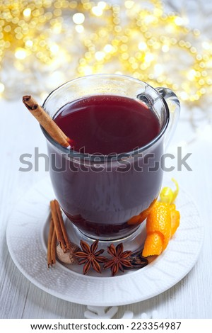 Hot red mulled wine with christmas spices - stock photo