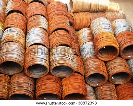 Hot rolled steel coil stacked outside. - stock photo
