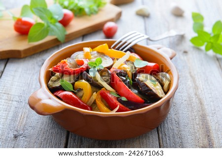 Hot salad from roasted aubergines and sweet pepper - stock photo