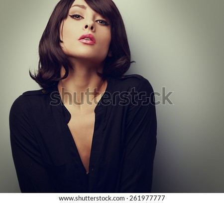 Hot sexy woman with short hair posing in black shirt. Vintage closeup portrait - stock photo