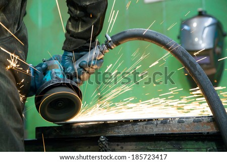 Hot sparks during grinding steel works - stock photo