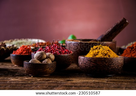 Hot spices in bowls, oriental theme - stock photo