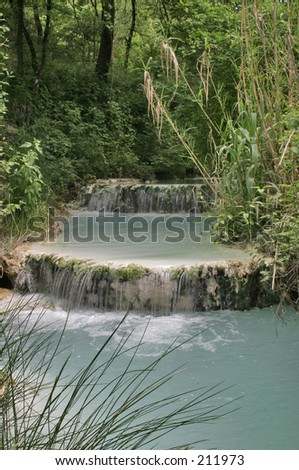 Hot Spring with waterfall - stock photo