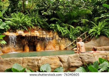 Hot springs with couple - stock photo