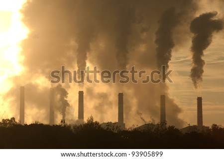 Hot steam from big chimney . - stock photo