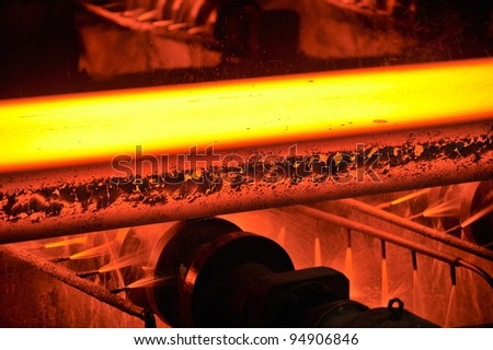 hot steel on conveyor - stock photo