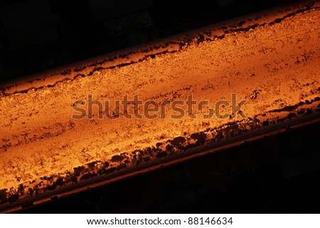 Hot steel on the production line. - stock photo