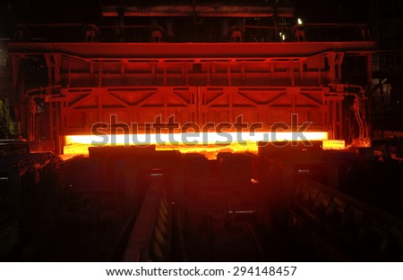 Hot steel on the production line  inside of steel plant - stock photo