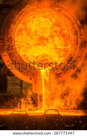 Hot steel pouring at steel plant - stock photo