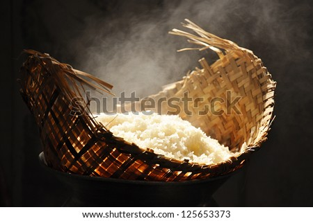 Hot sticky rice in old wooden steamer - stock photo