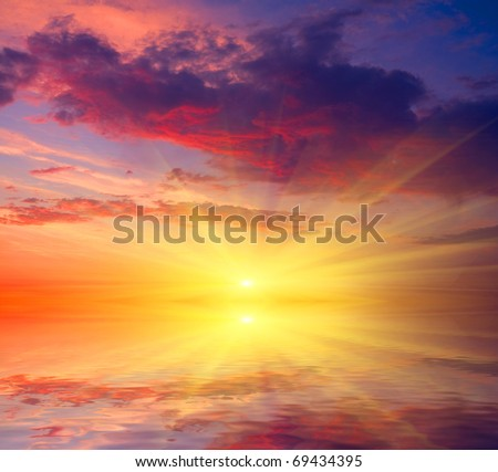 Hot sunset over lake water - stock photo