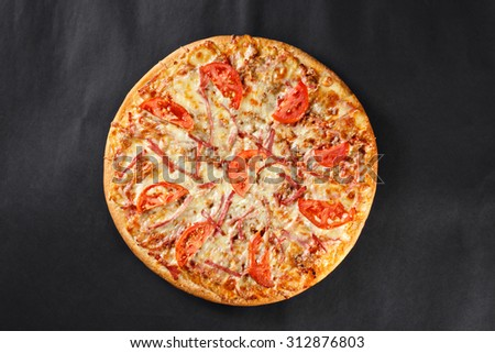 hot tasty delicious rustic homemade american pizza with tomato meat 