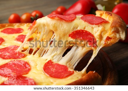 Hot tasty pizza with salami, close up - stock photo