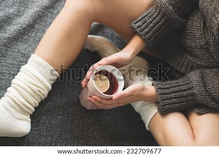 hot tea in bed  - stock photo