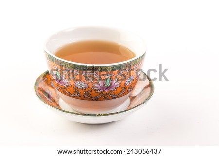 Hot Tea in Colorful Oriental or Middle Eastern design cup with geometric pattern and matching saucer.  Horizontal format with copy space. - stock photo