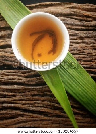 Hot tea on the wood background - Chinese style. - stock photo