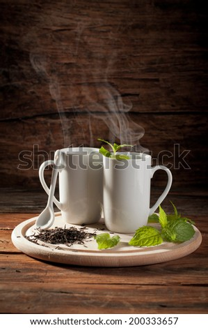 hot tea on wooden table - stock photo