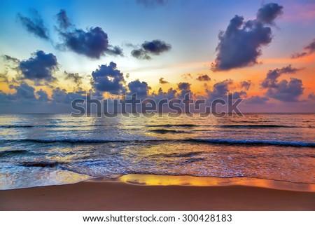 hot tropical sunset sky over sea beach background. - stock photo