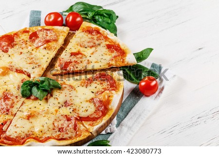 Hot true PEPPERONI rustic ITALIAN PIZZA with salami and cheese. TOP VIEW Tasty homemade pepperoni pizza on board on white wooden table. Copy space for your logo. Ideal for commercial  - stock photo