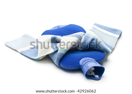 Hot Water Bottle wraped in scarf close up - stock photo