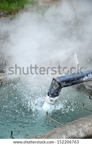 Hot water from geothermal spring to be transported by pipe  to fill the pool for mineral water. - stock photo